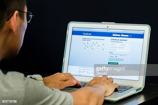 Logo and sign up page of Facebook the world's largest social networking site on a laptop screen on 30 June 2017 in Hong Kong Hong Kong