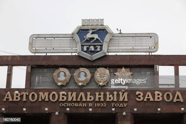 A logo and Sovietera Lenin signs stand at the entrance to the GAZ Group automobile plant in Niznhy Novgorod Russia on Tuesday Feb 5 2013 GAZ which is...