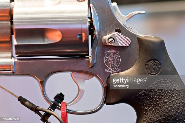 A logo appears on a revolver on display in the Smith Wesson booth on the exhibition floor of the 144th National Rifle Association Annual Meetings and...
