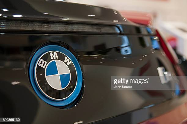A BMW logo badge on a new red and black BMW i8 Edrive on October 20 2016 in Southend United Kingdom