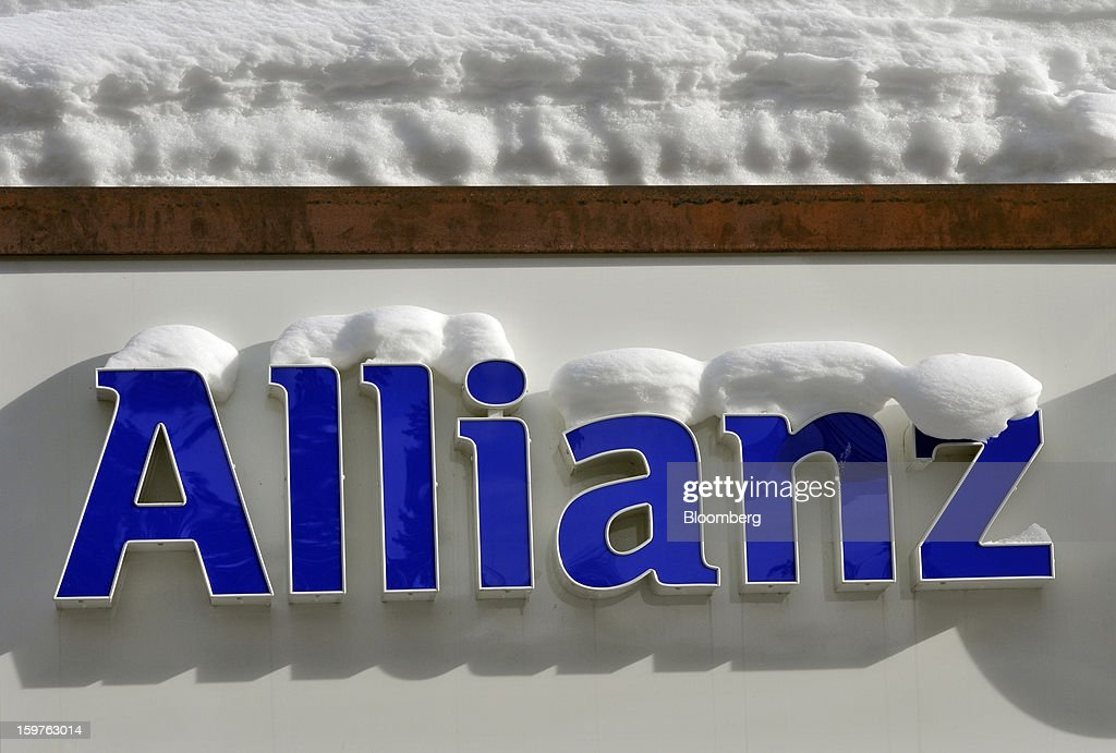 A logo for Allianz SE, Europe's biggest insurer sits covered in snow outside of a branch in the town of Davos, Switzerland, on Saturday, Jan 19, 2013. Next week the business elite gathers in the Swiss Alps for the 43rd annual meeting of the World Economic Forum in Davos, the five day event runs from Jan. 23-27. Photographer: Bryn Colton/Bloomberg via Getty Images