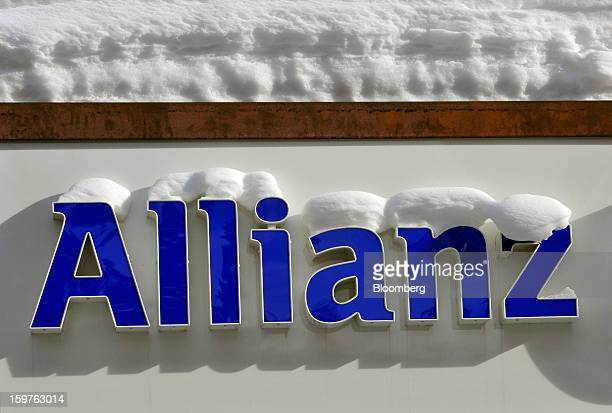 A logo for Allianz SE Europe's biggest insurer sits covered in snow outside of a branch in the town of Davos Switzerland on Saturday Jan 19 2013 Next...