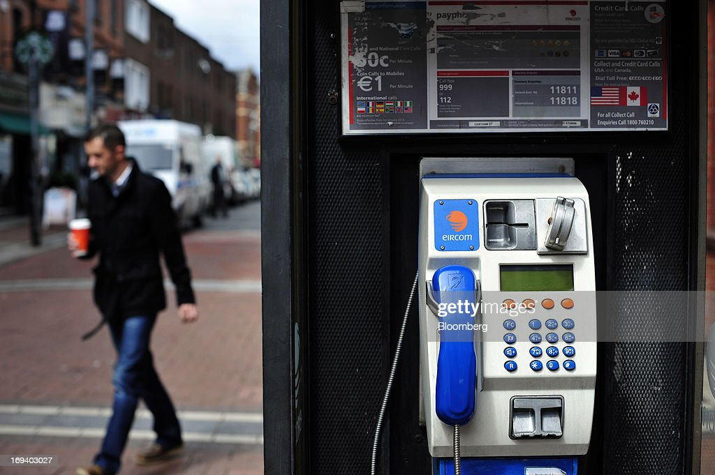 A logo for Eircom sits above a handset in a fixed-line public telephone booth, operated by Eircom Group, in Dublin, Ireland, on Thursday, May 23, 2013. Eircom Group, which has changed ownership six times since 1999, 'would like to be consolidators rather than consolidated' amid expected mergers and acquisitions in the Irish telecoms market, its Chief Financial Officer Richard Moat said. Photographer: Aidan Crawley/Bloomberg via Getty Images