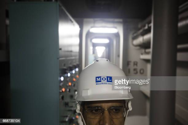 A logo for Mitsui OSK Lines Ltd is displayed on an helmet of a crew member onboard the MOL Triumph container ship docked at Kwai Tsing Container...