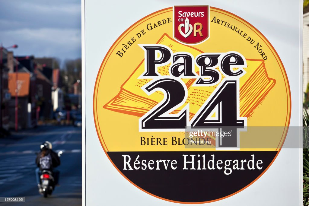 A logo for Page 24 beers, produced by the brewer Brasserie Saint Germain, is seen outside their brewery in Aix-Noulette, in France, on Monday, Nov. 26, 2012. Producers of beer in France, for instance, say any development plans they had have been 'nipped in the bud' by Hollande's plan to boost the tax on the drink next year. Photographer: Balint Porneczi/Bloomberg via Getty Images