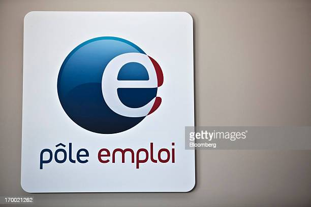 A logo for Pole Emploi the French national employment center sits on display inside a job center in Castelginest France on Wednesday June 5 2013...