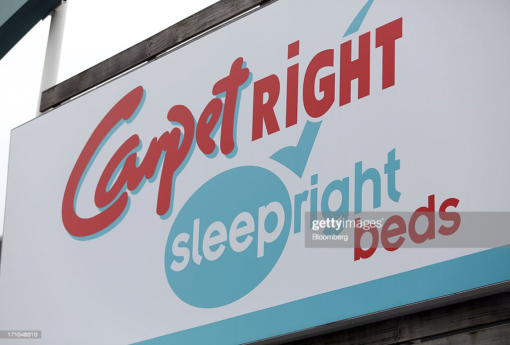 A logo for sleepright beds sits on a sign above the entrance to a Carpetright Plc carpet store in Basildon, U.K., on Friday, June 21, 2013. U.K. retail sales rose more than economists forecast in May as consumers spent more online and food sales increased at their fastest pace for more than two years. Photographer: Chris Ratcliffe/Bloomberg via Getty Images