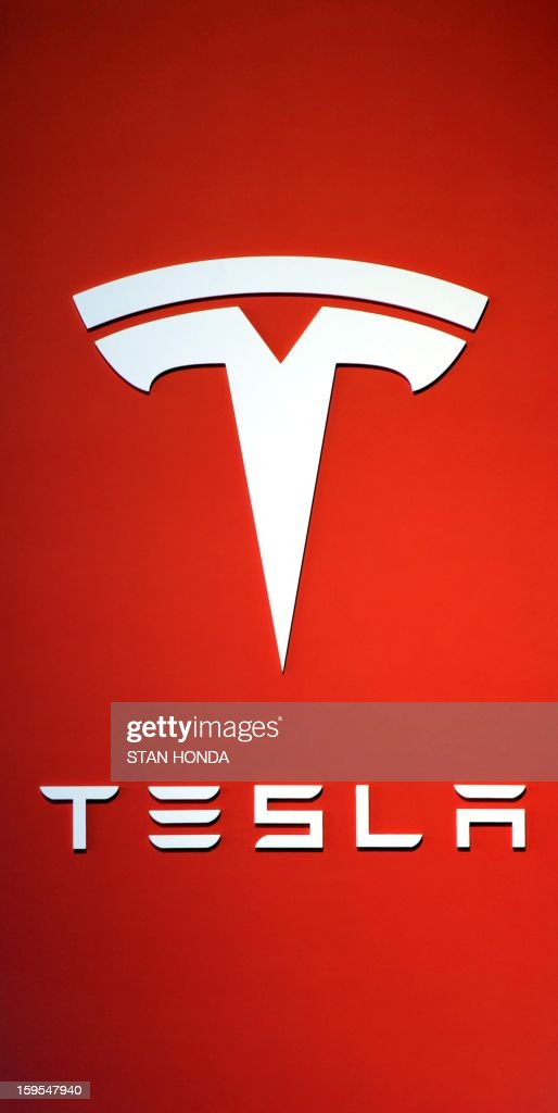 Logo for the Tesla Motors, maker of all electric cars, at the 2013 North American International Auto Show in Detroit, Michigan, January 15, 2013. AFP PHOTO/Stan HONDA