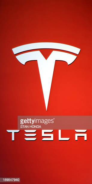 Logo for the Tesla Motors maker of all electric cars at the 2013 North American International Auto Show in Detroit Michigan January 15 2013 AFP...