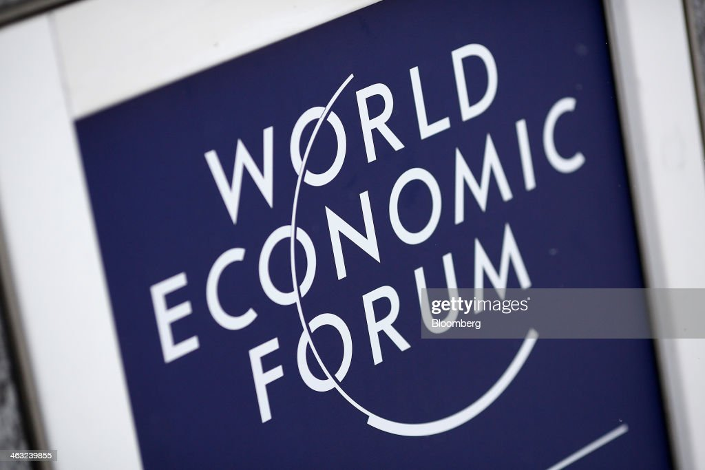 A logo for the World Economic Forum (WEF) sits on display outside the Kongress Zentrum, or Congress Center, in Davos, Switzerland, on Friday, Jan. 17, 2014. Next week the business elite will gather in the Swiss Alps for the 44th annual meeting of the World Economic Forum (WEF) in Davos for the five day event which runs from Jan. 22-25. Photographer: Simon Dawson/Bloomberg via Getty Images