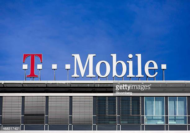 A logo for TMobile operated by Deutsche Telekom AG is seen on the top of the company's headquarters in Prague Czech Republic on Monday Feb 10 2014...