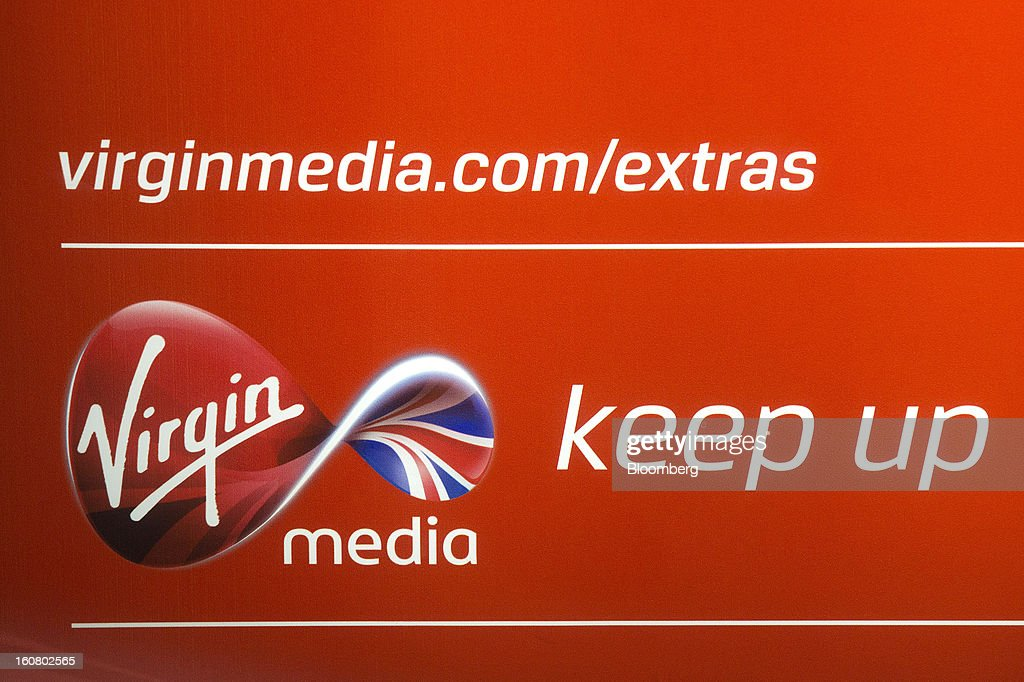 A logo for Virgin Media is seen on display at the company's headquarters on the Bartley Wood Business Park in Hook, U.K., on Wednesday, Feb. 6, 2013. Billionaire John Malone's Liberty Global Inc. agreed to acquire Virgin Media, Britain's second-largest pay-TV provider, in a $16 billion cash-and-stock transaction announced in the U.S. yesterday. Photographer: Simon Dawson/Bloomberg via Getty Images