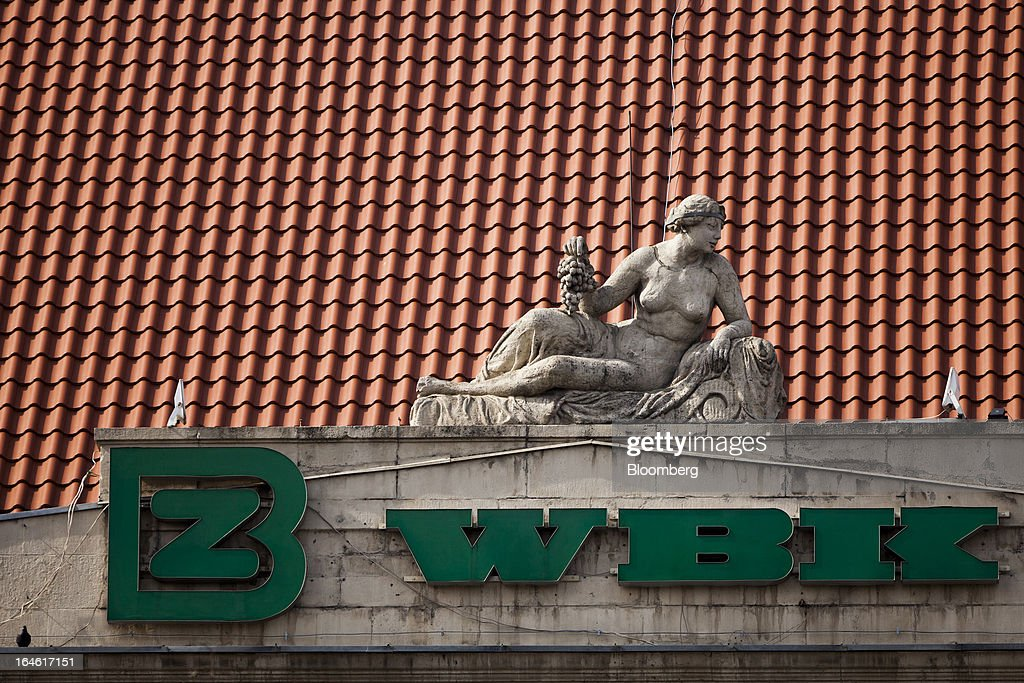 A logo hangs beneath a sculpture on the rooftop of a Bank Zachodni WBK SA branch in Wroclaw, Poland, on Monday, March 25, 2013. KBC Groep NV of Belgium and Banco Santander SA of Spain raised 4.89 billion zloty ($1.51 billion) from the sale of a stake in Bank Zachodni WBK SA, Poland's third-largest lender. Photographer: Bartek Sadowski/Bloomberg via Getty Images