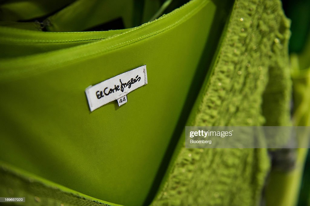 A logo hangs from an item of women's clothing for sale inside an El Corte Ingles SA department store in Barcelona, Spain, on Thursday, May 30, 2013. Spain's recession eased in the first quarter as domestic demand stabilized while exports, which the government says will drive the recovery of the euro-area's fourth-largest economy, fell at the fastest pace in a year. Photographer: David Ramos/Bloomberg via Getty Images