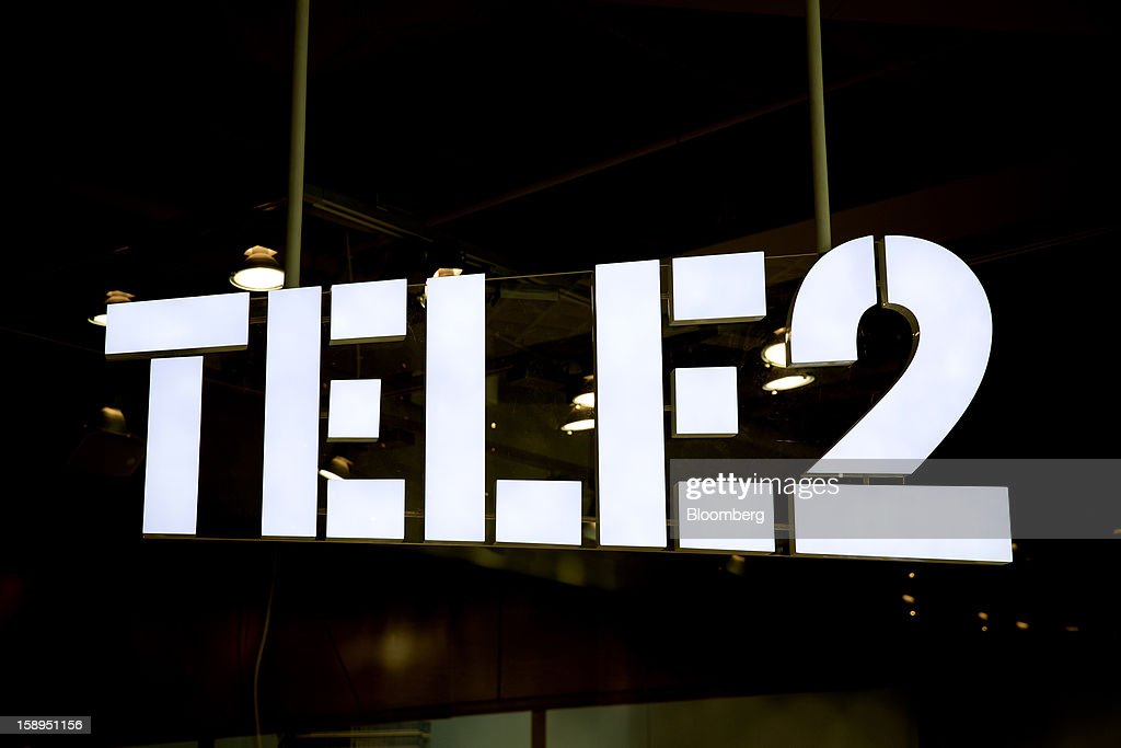 A logo hangs on display at a Tele2 AB store inside the Farsta Centrum shopping center in Stockholm, Sweden, on Friday, Jan. 4, 2013. OAO Rostelecom's largest owner after the Russian state, Konstantin Malofeev, is urging the country's dominant fixed-line operator to buy the local unit of Sweden's Tele2 AB to form a fourth nationwide wireless carrier. Photographer: Casper Hedberg/Bloomberg via Getty Images