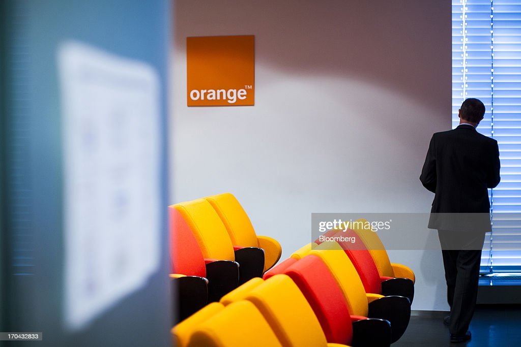 A logo hangs on display at the headquarters of Orange Polska, also known as Telekomunikacja Polska SA (TPSA), Poland's national telecommunications company, in Warsaw, Poland, on Wednesday, June 12, 2013. Cable providers are being drawn to Poland, the European Union's biggest eastern economy, because penetration levels are half that of neighboring Germany even as unemployment rises, according to a website presentation by the country's biggest TV network, Cyfrowy Polsat SA. Photographer: Bartek Sadowski/Bloomberg via Getty Images