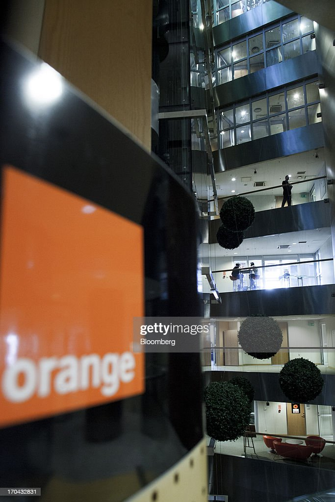 A logo hangs on display inside the headquarters of Orange Polska, also known as Telekomunikacja Polska SA (TPSA), Poland's national telecommunications company, in Warsaw, Poland, on Wednesday, June 12, 2013. Cable providers are being drawn to Poland, the European Union's biggest eastern economy, because penetration levels are half that of neighboring Germany even as unemployment rises, according to a website presentation by the country's biggest TV network, Cyfrowy Polsat SA. Photographer: Bartek Sadowski/Bloomberg via Getty Images