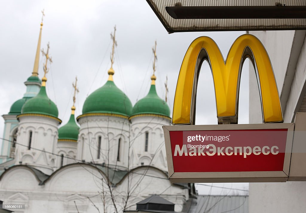 A logo hangs on display outside a McDonald's food restaurant in Moscow, Russia, on Sunday, April 7, 2013. McDonald's Corp., which virtually created the market for burgers and fries in the country and convinced Russians it's OK to eat with their hands, must fend off a growing challenge from rivals Burger King Worldwide Inc., Subway Restaurants, Yum! Brands Inc. and Wendy's Co. Photographer: Andrey Rudakov/Bloomberg via Getty Images