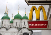 A logo hangs on display outside a McDonald's food restaurant in Moscow Russia on Sunday April 7 2013 McDonald's Corp which virtually created the...