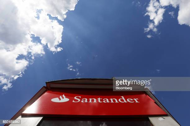 A logo hangs outside a bank branch of Banco Santander SA in London UK on Tuesday Aug 15 2017 Banco Santander Spains biggest lender has bought...