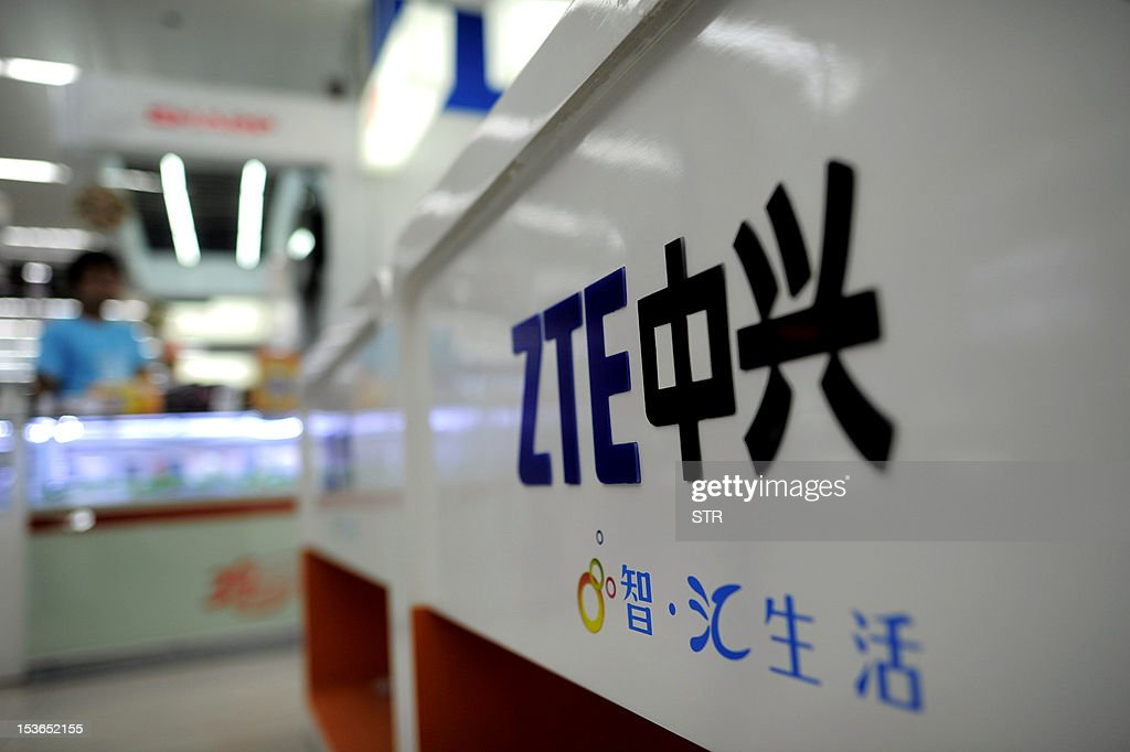 A ZTE logo is diplayed on a sales counter in Wuhan, central China's Hubei province on October 8, 2012. Beijing on October 8 urged Washington to 'set aside prejudices' after a draft Congressional report said Chinese telecom firms Huawei and ZTE were security threats that should be banned from business in the US. CHINA