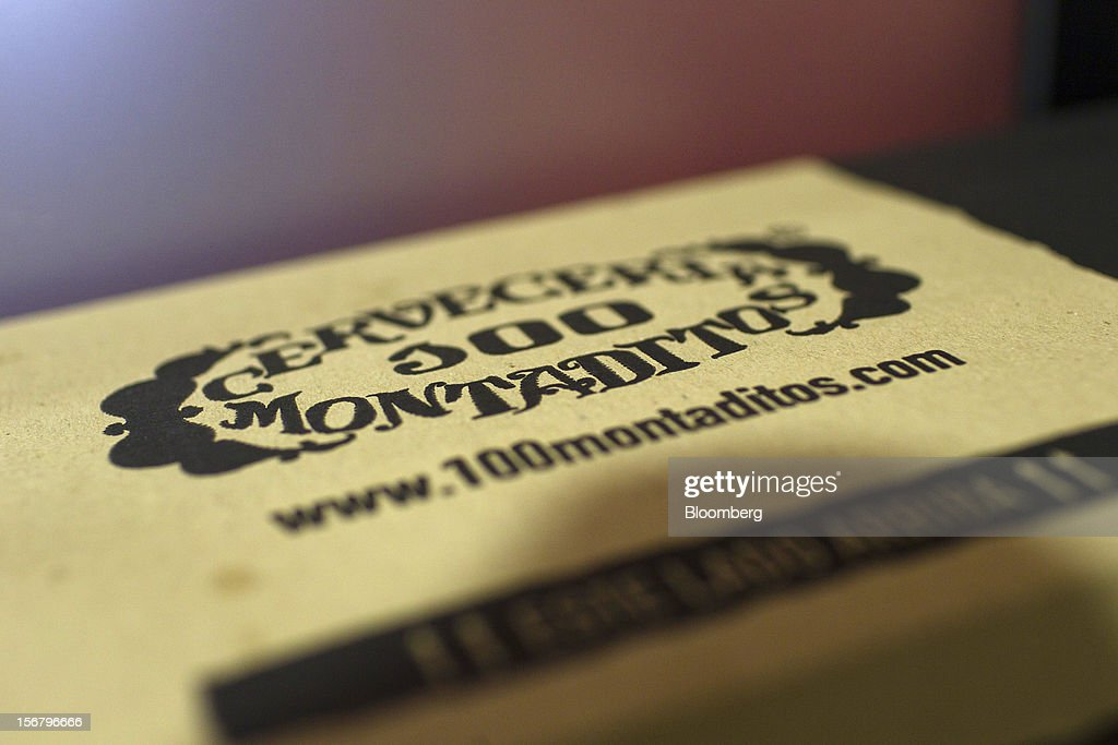 A logo is displayed on a food box at a 100 Montaditos restaurant in Madrid, Spain, on Wednesday, Nov. 21, 2012. The Madrid-based chain in January opened its first U.S. restaurant in Miami and aims to have eight outlets in Florida by next March. Photographer: Angel Navarrete/Bloomberg via Getty Images