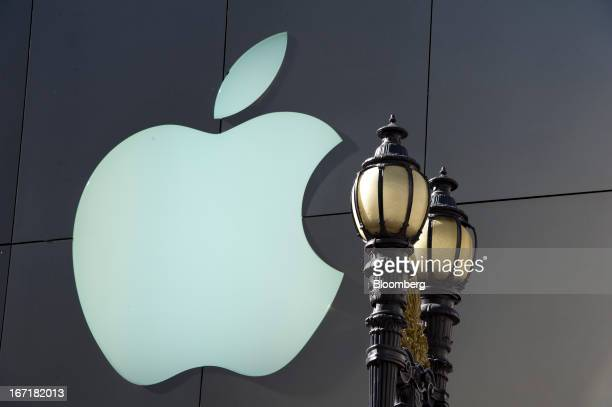 A logo is displayed on the facade of an Apple Inc store in San Francisco California US on Friday April 19 2013 Apple Inc is expected to release...