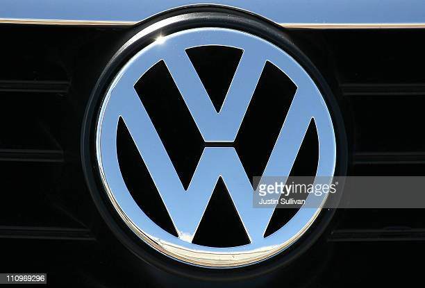 A logo is displayed on the front grill of a brand new Volkswagen car at a Volkswagen dealership on March 28 2011 in San Rafael California Volkswagen...