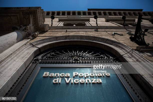 A logo is displayed on the window of a Banca Popolare di Vicenza SpA bank branch in Rome Italy on Monday June 26 2017 Italy orchestrated its biggest...