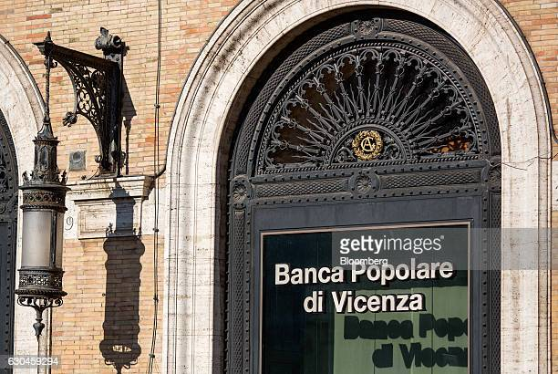 A logo is displayed on the window of Banca Popolare di Vicenza SpA bank branch in Rome Italy on Friday Dec 23 2016 The nationalization of Banca Monte...