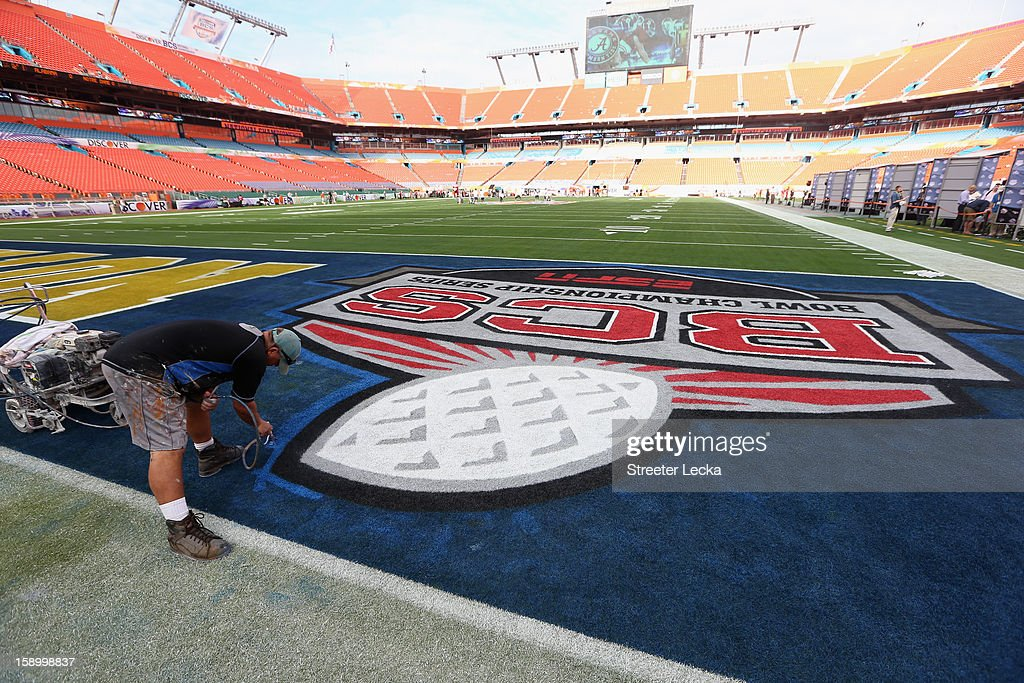 A logo is painted in the endzone by a worker during Media Day ahead of the Discover BCS National Championship at Sun Life Stadium on January 5, 2013 in Miami Gardens, Florida.
