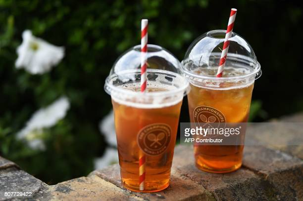 A logo is pictured on plastic cups at The All England Lawn Tennis Club in Wimbledon southwest London on July 4 2017 on the second day of the 2017...