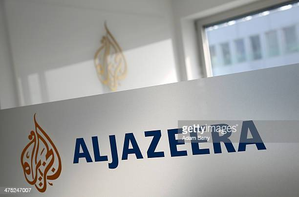 A logo is seen at the Al Jazeera bureau in Berlin after a demonstration for the news organization's reporters currently in jail in Cairo as well...
