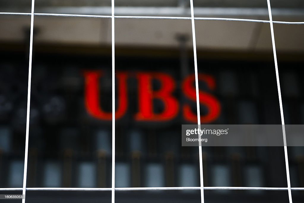 AG logo is seen beyond a security fence during construction work outside the company's offices in Geneva, Switzerland, on Sunday, Feb. 3, 2013. UBS AG will report fourth-quarter results for the 2012 financial year on Feb. 5. Photographer: Valentin Flauraud/Bloomberg via Getty Images