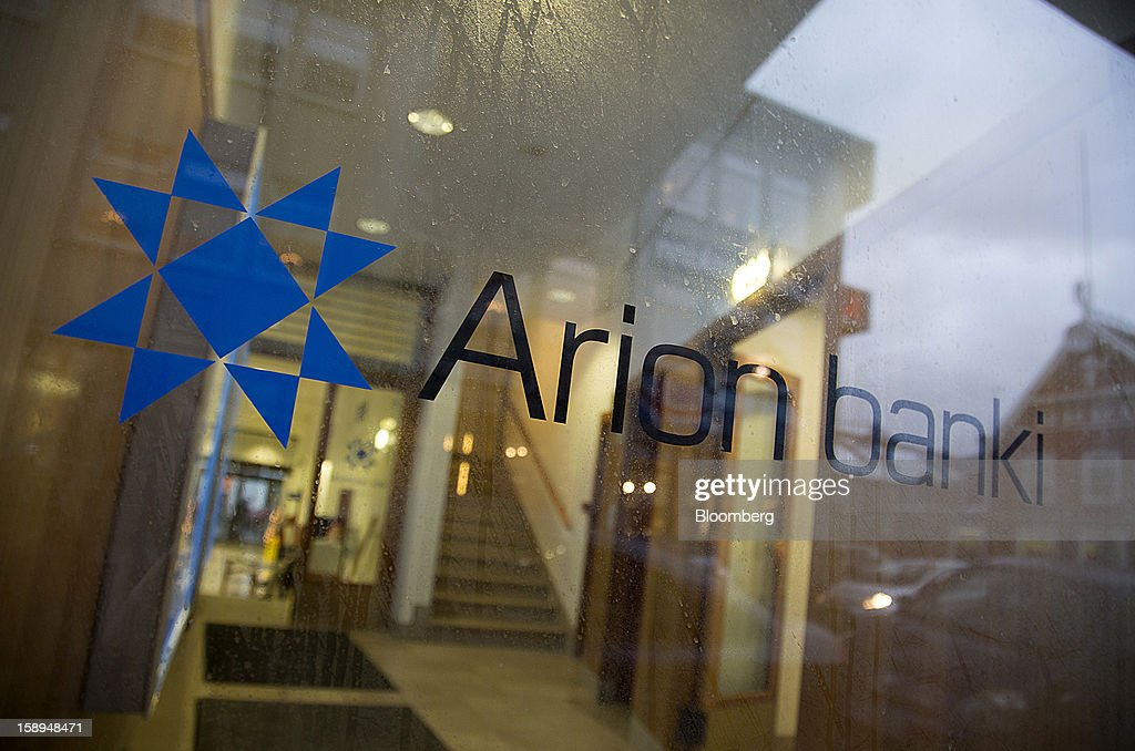 A logo is seen in the window of an Arion Banki hf bank branch in Reykjavik, Iceland, on Wednesday, Jan. 2, 2013. Creditors of Iceland's three biggest failed banks are fighting for a waiver to krona controls imposed in 2008 amid risks pay-outs will be delayed beyond 2015. Photographer: Arnaldur Halldorsson/Bloomberg via Getty Images