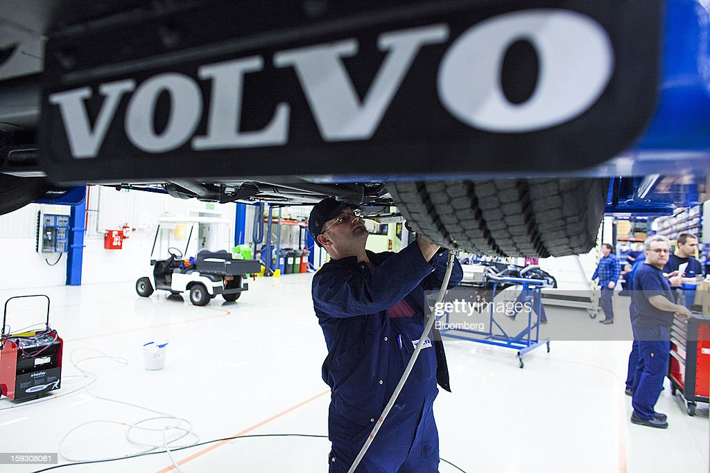 A logo is seen on a mud flap as an employee works near the wheel assembly of a bus at Volvo AB's manufacturing plant in Wroclaw, Poland, on Friday, Jan. 11, 2013. Volvo plans to end bus making in Saeffle by June 2013, and will consolidate the business in Europe to its main plant in Wroclaw, Poland, the Gothenburg, Sweden-based company said. Photographer: Bartek Sadowski/Bloomberg via Getty Images
