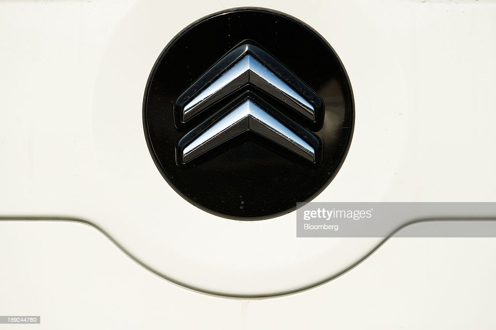 A logo is seen on the hood of a PSA Peugeot Citroen Nemo van in a shipping terminal parking lot at Barcelona port in Barcelona, Spain, on Thursday, Jan. 10, 2013. Spanish exports grew the least in five months in September as the euro area relapsed into a recession and the region's fourth-largest economy continued to contract. Photographer: David Ramos/Bloomberg via Getty Images