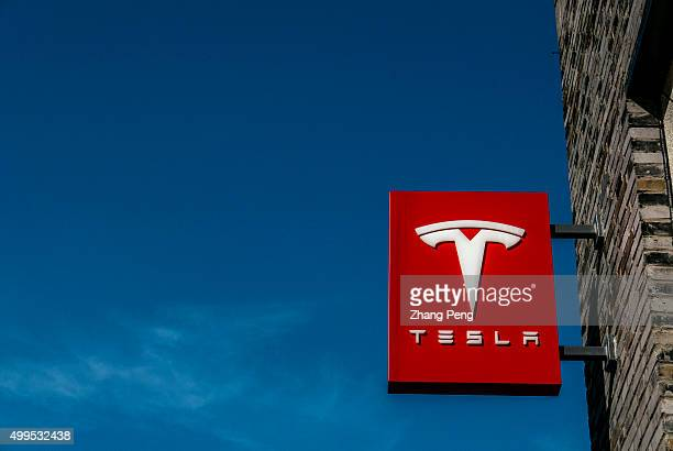 Logo of a Tesla Motors store in Hangzhou downtown Tesla Motors is an American automotive and energy storage company selling luxury electric cars and...