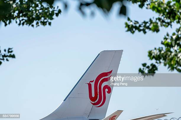 Logo of Air China on a plane tail Air China leading Chinese carrier has transported 802 million passengers in April marking an 85% jump on the year...