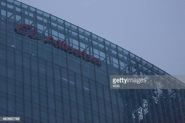 A logo of Alibaba is seen in Wangjing's Greenland Center 3rd Building on February 2 2015 in Beijing China Alibaba Group prepared to enter capital's...
