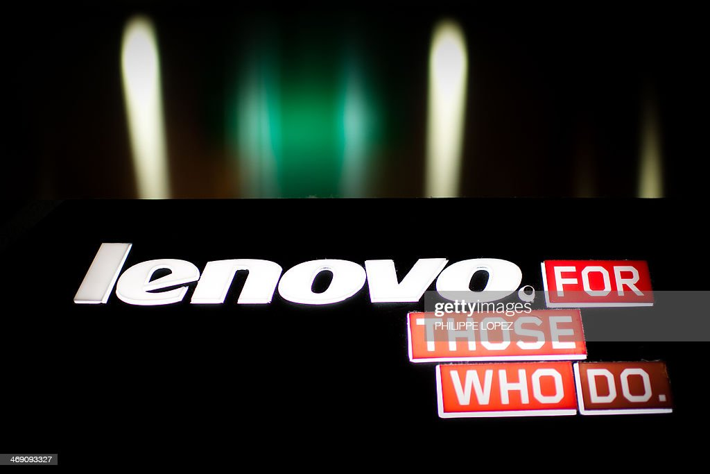 A logo of Chinese computer giant Lenovo is displayed in Hong Kong on February 13, 2014. Lenovo Chairman Yang Yuanqing pledged on February 13 to make the company the world's third-biggest smartphone seller following an acquisition binge as the firm announced a 30 percent profit surge. AFP PHOTO / Philippe Lopez