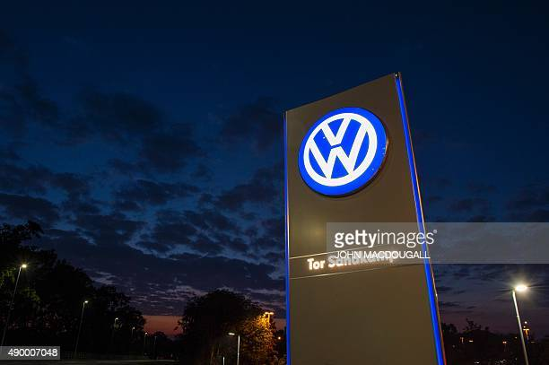 A logo of German car manufacturing giant Volkswagen is seen outside their headquarters in Wolfsburg on September 25 2015 AFP PHOTO / JOHN MACDOUGALL...