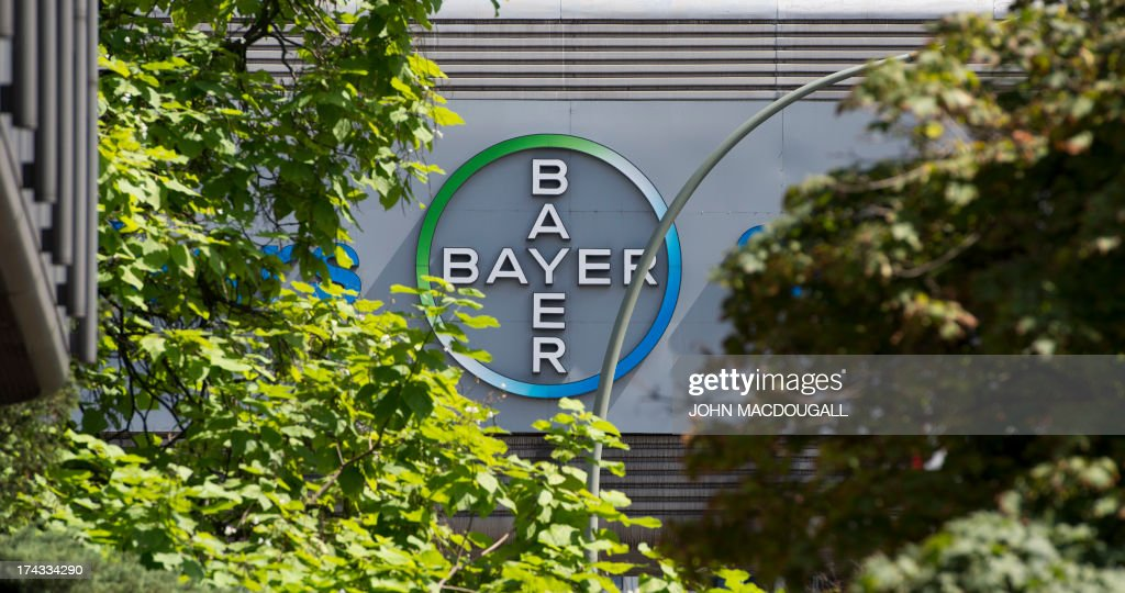 A logo of German pharmaceutical giant Bayer appears on an overpass at its Berlin headquarters July 24, 2013. The company, that invented Aspirin in 1897, celebrates its 150th birthday on August 1, 2013.