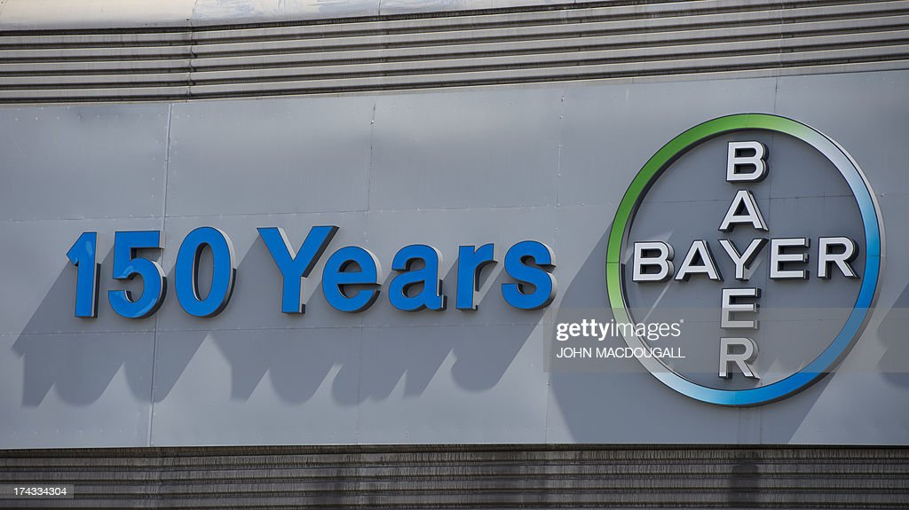 A logo of German pharmaceutical giant Bayer appears on an overpass at its Berlin headquarters July 24, 2013. The company, that invented Aspirin in 1897, celebrates its 150th birthday on August 1, 2013. AFP PHOTO / JOHN MACDOUGALL