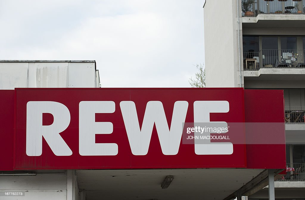 A logo of German supermarket chain REWE appears on one of their outlets in Berlin April 29, 2013. Employees were temporarily monitored illegally at Penny south, a discount subsidiary of Rewe, the company admitted on April 29, 2013. AFP PHOTO / JOHN MACDOUGALL