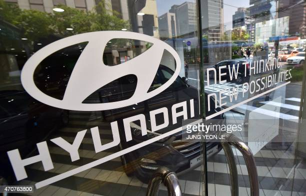 A logo of Hyundai Motor is seen on a glass door at its branch in Seoul on April 23 2015 South Korea's top automaker Hyundai Motor posted a 22 percent...
