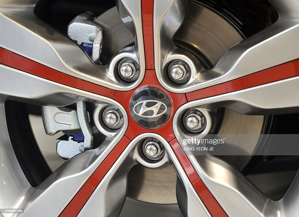 A logo of Hyundai Motor is seen on a wheel at its branch in Seoul on January 24, 2013. South Korea's Hyundai Motor reported a 12 percent increase in net profit for 2012, despite the global downturn sapping demand and a strengthening won.