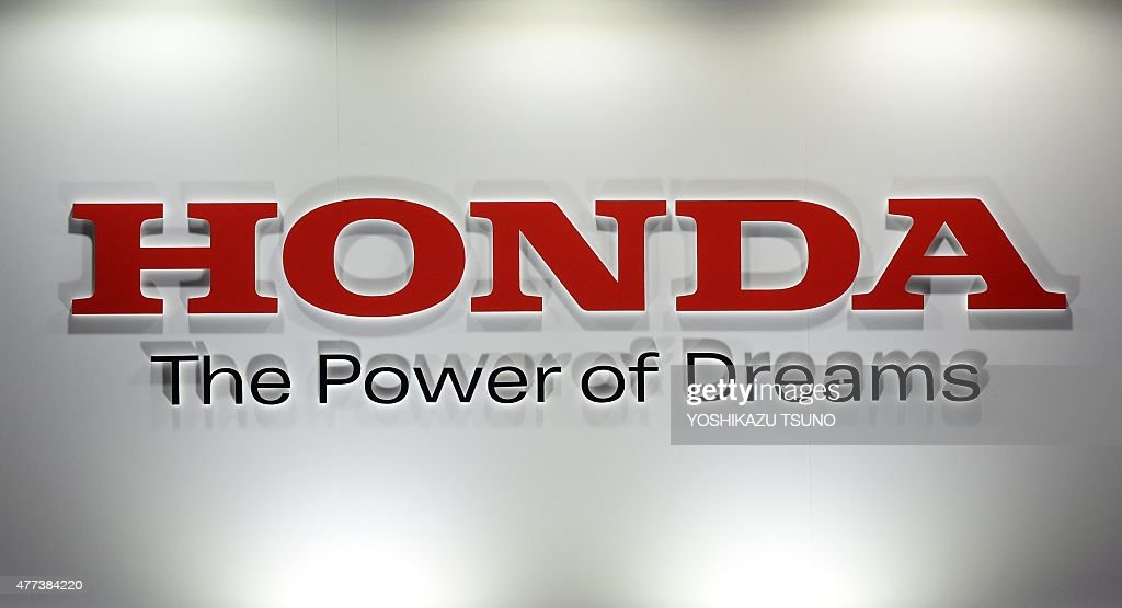 A logo of Japanese auto giant Honda Motor is displayed at the Smart Community exhibition in Tokyo on June 17 2015 Honda held the company's...