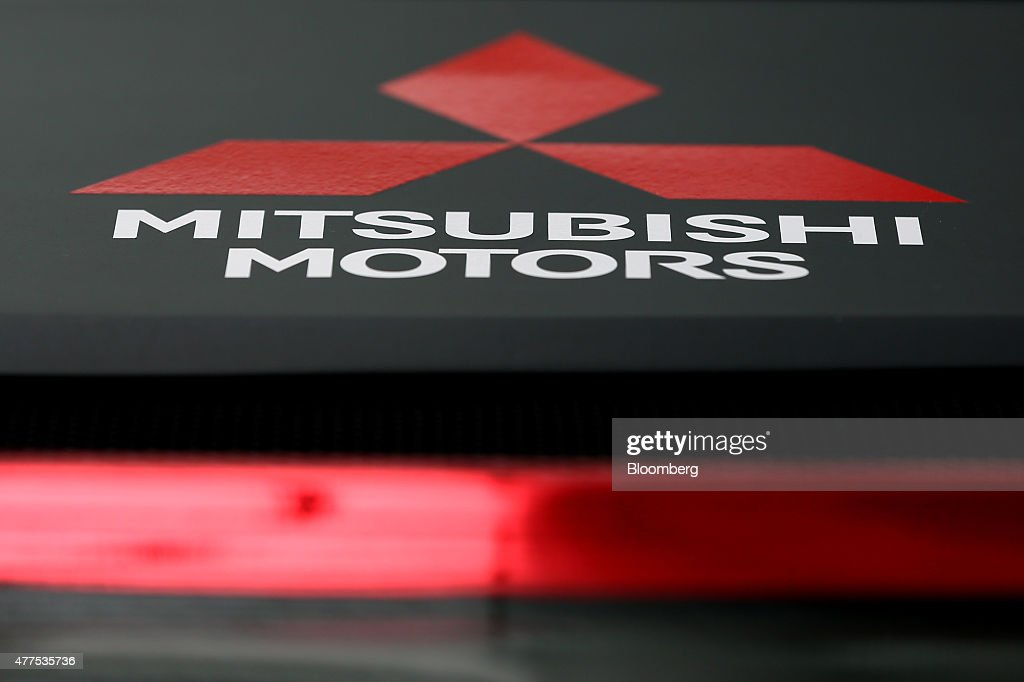 A logo of Mitsubishi Motors Corp is seen on the company's Outlander PHEV rally car during its unveiling at the company headquarters in Tokyo Japan on...