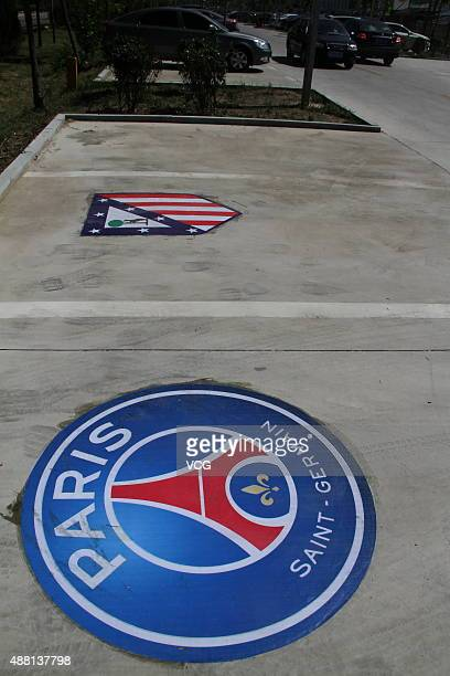 A logo of Paris SaintGermain is painted on the ground of the parking space at a football park on September 13 2015 in Binzhou Shandong Province of...